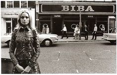 Manager Eleanor Powell outside the BIBA Kensington Church Street shop in 1967 via flickr.