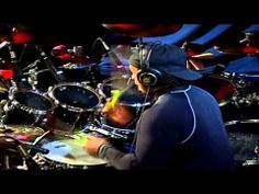 Carter Beauford of the Dave Matthews band-One of most AMAZING drum performances...watch him switch drum sticks in with his mouth while still keeping the beat!!!