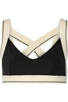 Olympia Activewear designer Kaili Lickle is drawn to answer the need for functional yet simple workout pieces. This 'X' sports bra is cut from moisture-wicking stretch-jersey with crossover straps and a thick underband for flexibility and comfort. Wear yours to yoga class with the matching leggings.