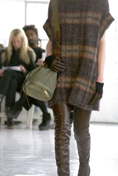 dress...leathers....bag....guy in background!