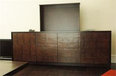 Modern custom made cabinet with TV-lift remote control. Bamboo and oak furniture by Aguirre Design Inc on HomePortfolio