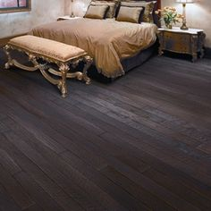 Dark wide plank floors from the Anderson Hickory Forge hardwood flooring collection. These beautiful floors can fit into almost any décor from rustic, tuscan, or traditional.