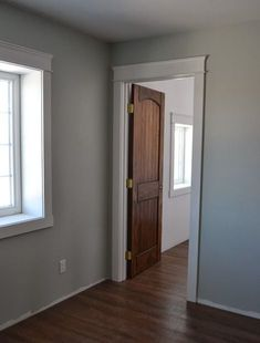 Modern Casing and Headers with wood doors and floors! Interior Window Trim, Interior Barn Doors, White Baseboards, Modern Baseboards, Baseboard Styles, Doors And Floors, House Trim, Farmhouse Interior, Farmhouse Front