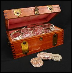 treasure chest and silver dollars by Renaude Hatsedakis