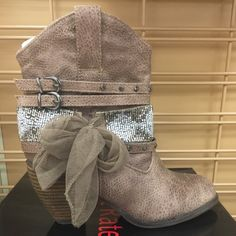 """24hr Flash SaleAnkle Embellished Cowboy Boots NO TRADES, PRICE FIRM! Very unique pair of cowboy boots! Brand New in box. The color is actually labeled """"taupe"""". Studded, beaded sccent straps, with lace bow embellishments. Heel Height is Approximately 2 1/2"""". Cushioned footbed, faux leather, stacked heel, medial zipper entry. They can be worn all year to add some spice to a cute outfit! These beauty's are Only for the REAL Fashionista's Not Rated Shoes Ankle Boots & Booties"""