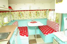 inside of Elsie the vintage travel trailer rehabbed at pocketfullofwhimsy.blogspot love love the heather bailey fabric.awesome!