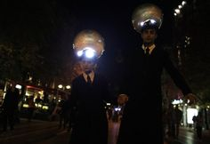 Artists take part in Luxlumina light performance during the first annual festival of visual theatre on a street in downtown Sofia
