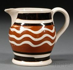 Small Mochaware Jug, Britain, c. 1830, baluster-form pearlware jug banded with brown and black slip with white slip trailed waves
