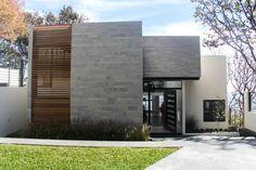 Fachada principal: Casas de estilo Moderno por aaestudio