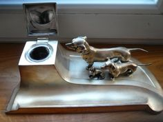 Silver plated inkwell with dogs