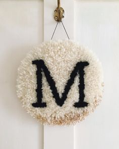 M is for mmmmmmm or whatever else you'd like it to stand for. Custom monogrammed wall hangings are available to order now! Monogram Wall Hangings, Latch Hook Rugs, Punch Needle, Punch Art, Rug Hooking, Fiber Art, Hand Embroidery, Weaving, Couture
