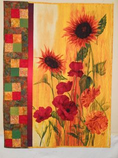 Sunflower Quilt - I love sunflowers and found this pattern and panel online at The Pine Needle Quilt Shop. It was a very easy quilt to make, and I used fabric I had on hand. I just got it back from our county fair where it won a blue ribbon and a Peoples' Choice award.