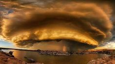 Across the Pond; absolutelly stunning view over the supercell at sunset in Arizona. WOW!  Source: Bob Larson