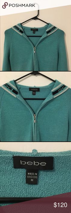 """Bebe Sport Hoodie  NWOT Light Teal """"Bebe Sport Hoodie."""" It's amazingly gorgeous and RARE! The Bebe Sport Line has been discontinued since April 2016. BBSP clothes run small. Says """"M,"""" and will fit a woman size 4-6, the BEST... Is a full zip hoodie with 2 small open pockets on its sides. This is awesome to wear on: a brisk walk, jog, gym workout, causal days, or staying warm/sexy around the house... Bebe Sport Jackets & Coats"""