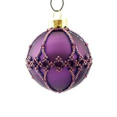 This listing is for these specific 6 beaded baubles in pink and purple colours with the filigree pattern. (buy 6 pay for 5) All the beadcovers are made from the same colour beads, which makes these baubles go really well together as a set. 3 matte + 3 shiny baubles. Hangers not
