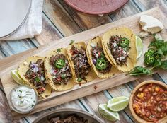 Let your slow cooker do all the hard work in making these barbacoa tacos. The beef is moist, delicious and full of flavor.