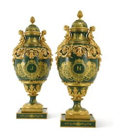 A PAIR OF NAPOLÉONIC SÈVRES-STYLE IMPERIAL GREEN-GROUND PORCELAIN VASES AND COVERS FRANCE, EARLY 20TH CENTURY