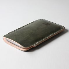 Leather sleeve for iPhone6 hand stitched with legendary saddle stitching technique, waxed thread and beautifully burnished edges #timogoods #leather #handmade #madeinchile