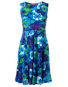 Sleeveless tricot dress with wide shoulder straps. The dress is cut at the waist and is gored below the waist. Blue, purple and green flower dress from Indiska http://indiska.com/fi/Clothing/Dress/TRACY-FLOWER/p/103717848MULTI
