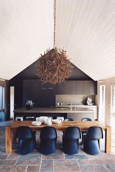 navy chairs + twig pendant