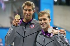 Gold medalist Matt Grevers of the United States and silver medalist Nick Thoman of the United States celebrate with their medals during the medal ceremony for the Men's 100m Backstroke on Day 3 of the London 2012 Olympic Games at the Aquatics Centre on July 30, 2012 in London, England.