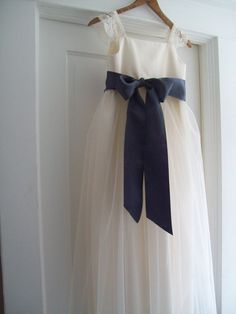 Flower girl dress for a slightly older girl. Lace and tulle, very pretty!