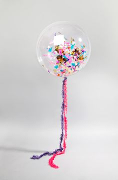 Love this idea...glitter in balloons....as long as they don't pop in the house!