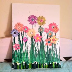 Crayon art...with added flowers and buttons!:)
