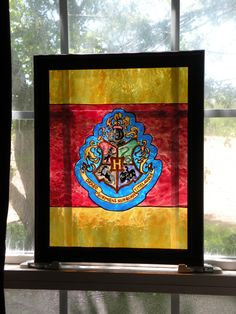 Hogwarts Crest Harry Potter Faux Stained Glass Painted Art Gryffindor Slytherin Hufflepuff Ravenclaw Window Suncatcher Panel by StardustStudiosGlass on Etsy https://www.etsy.com/listing/237890354/hogwarts-crest-harry-potter-faux-stained