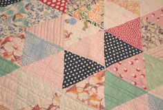 This listing is for a colorful 24-inch by 15-inch piece of a vintage patchwork cutter quilt with triangles that are 5 inches on two sides and 4-1/2