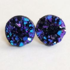 3 for 15 purple-blue Druzy Drusy style studs Handmade by me chunky acrylic blue-purple iridescent metallic Drusy style small 10mm earrings on silver tone lead and nickel free post. Clear rubber backing. 3 pairs for $15. Minimum purchase is $15. Additional pairs $5. Price firm. Can mix/match Drusy style or picture earrings. Each piece varies slightly in shape and is unique jagged. Made of acrylic resin. #drusy #druzy #druzyearrings  DOES NOT WORK WITH ADD TO BUNDLEPlease comment under the…
