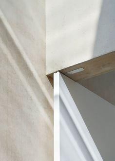 minimal-white-extension-to-traditional-british-home-13-door-corner.jpg