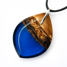 Navy blue resin and sustainable jackfruit wood on black cord # necklace # gift Resin Jewelry, Cord, Navy Blue, Pendant Necklace, Natural, Gifts, Handmade, Black, Design