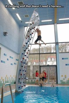 Climbing wall above pool , doesn't need a harness. Awesome!
