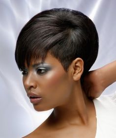 A short black straight relaxed ethnic hairstyle by Hair Studio