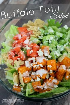 Buffalo Tofu Salad - Crispy tofu over a delicious green salad; then adding celery, tomatoes, tortilla chip crumbles,bleu cheese, and creamy ranch is the perfect combination.