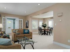 Living room opens to dining room & kitchen  177 Walton Dr, Amherst, NY | $239,900