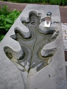 Detail of water fountain, incorporating the oak leaf theme of the Ruin Garden.