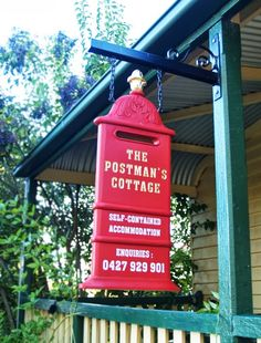 A Sign for The Postman's Cottage, in Inverell. We designed the sign to look like an antique red post box.