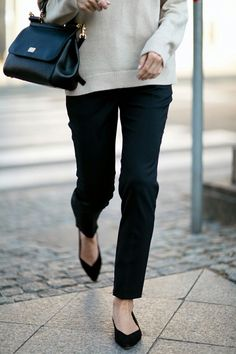 Sweater, causal straight leg black pant, and flats.