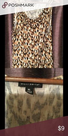 FUN Leopard/animal print tank Leopard/animal print, drape neck tank.  Lightweight-  perfect to wear layered or by itself.  Goes great with black pants or pair it with jeans!  Willi Smith brand.  Comes from Smoke free/pet free home. Willi Smith Tops Tank Tops