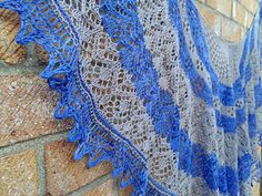 A beautiful, delicate lace shawl resembling a Spanish fan. Light & airy, this is the perfect accessory for a evening dress or a glamorous accessory for casual daytime. Spanish Fan is worked form the top down with a knitted on edging – see www.yarnaddict.co.uk for a video tutorial.
