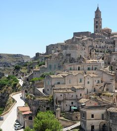 Matera, Italy- medieval village of cave houses built into the rock. Was virtually abandoned for modern homes, but now being restored. Amazing history!