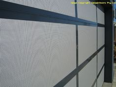 Perforated mesh insert garage door close up Custom Garage Doors, Custom Garages, Perth Western Australia, New Home Designs, Blinds, New Homes, Mesh, Exterior, House Design
