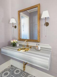 Beautiful marble vanitey in this powder room | Munger Interiors