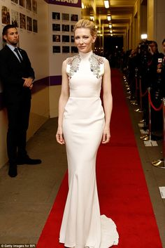 Belle of the ball: Cate Blanchett wowed in a figure-hugging white gown as she attended the...