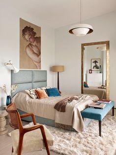 Dormitorio principal en azul y arena