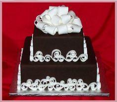 Chocolate fondant with white gumpaste swirls and gumpaste bow.