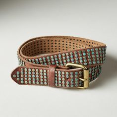 "SANDIA BELT -- Low studs, splashed with turquoise, give a vintage look and sleek handfeel to our supple, leather belt. Imported. Exclusive. Sizes S/M (34""), M/L (36""). Approx. 1-3/4""W."