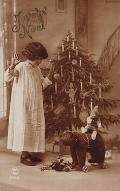 Christmas Wishes! Vintage girl with toy bear on wheels, antique Victorian Christmas photo postcard. Vintage Christmas Photos, Victorian Christmas, Retro Christmas, Vintage Holiday, Christmas Pictures, Vintage Photos, Primitive Christmas, Country Christmas, Outdoor Christmas